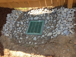 "24"" Catch Basin encased in 3' Concrete Bowl finished with 1"" Chalet Stones"